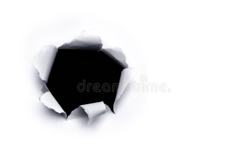 Furo de papel no fundo branco foto de stock