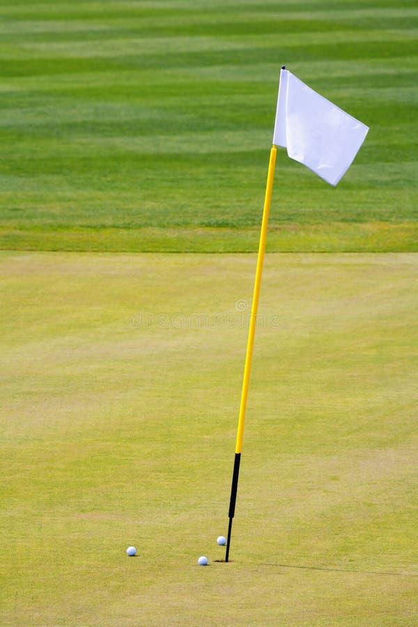 Furo do golfe com uma bandeira fotografia de stock royalty free