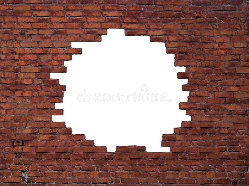 Furo grande na parede de tijolo fotografia de stock royalty free