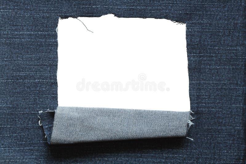 Furo nas calças de brim Textured imagens de stock