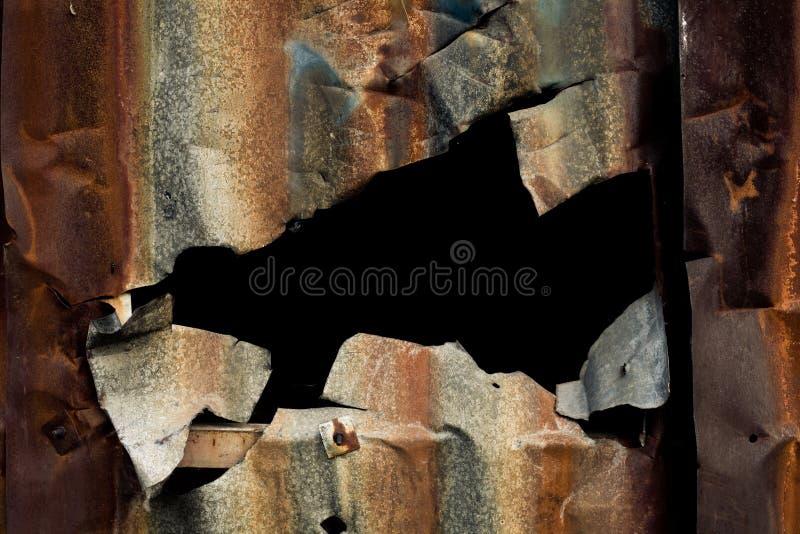 Furo no metal oxidado imagens de stock royalty free