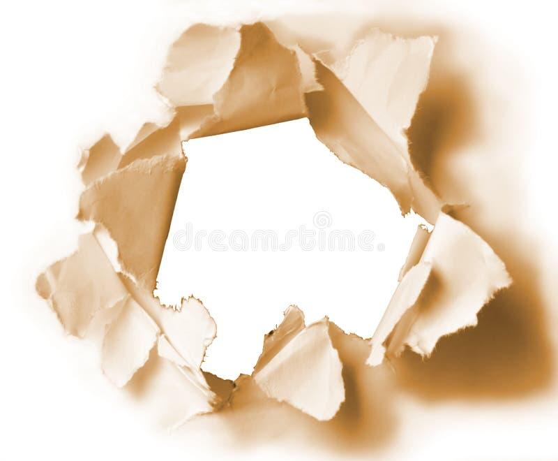Furo no papel do sepia imagens de stock