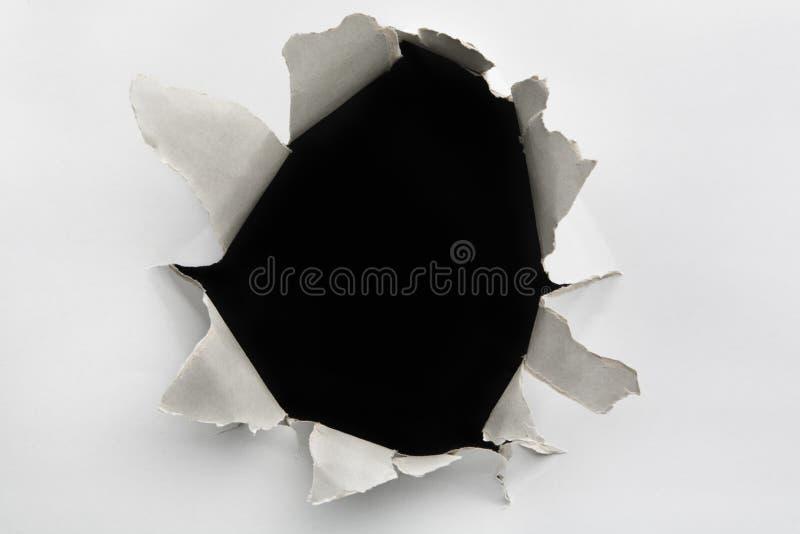 Furo vazio em parede rachada imagens de stock