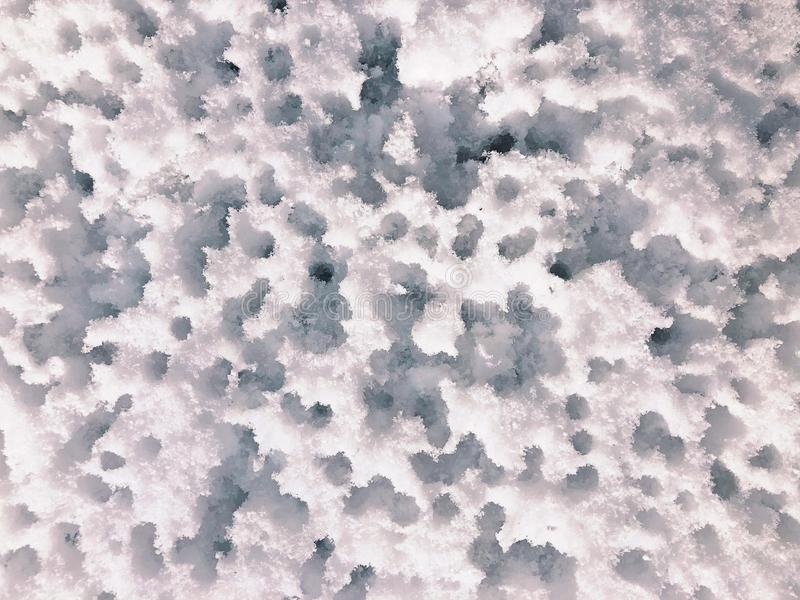 Furos de água na neve imagens de stock