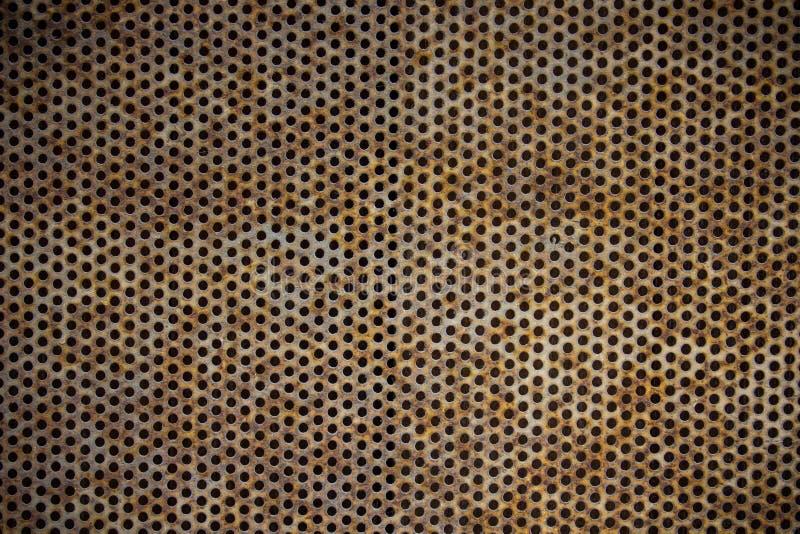 Furos oxidados da placa de metal imagens de stock