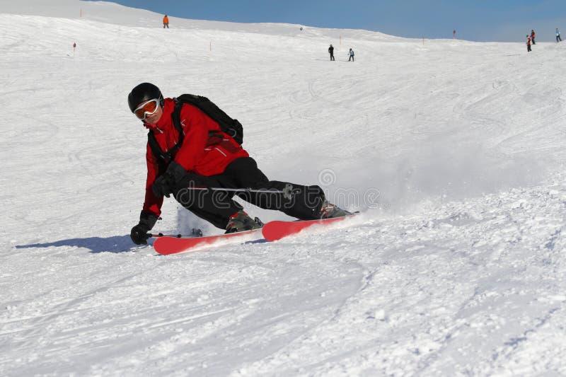 Furrowing skier