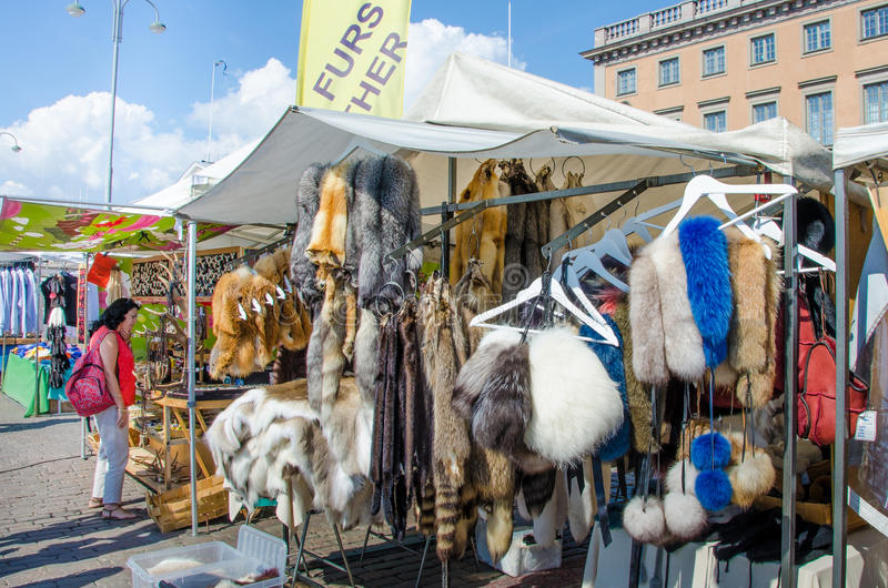 Furs for sale at an outdoor market in Helsinki, Finland. HELSINKI, FINLAND AUGUST 8, 2014 Furs are for sale at an outdoor market in the Finnish capital royalty free stock image
