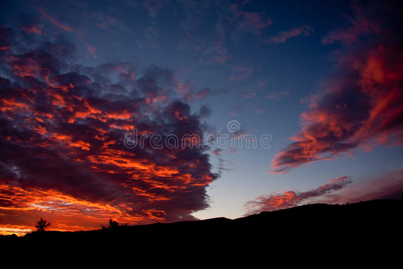 The fury of nature. Desert at sunset goes from reds to oranges during the monsoon season royalty free stock photography
