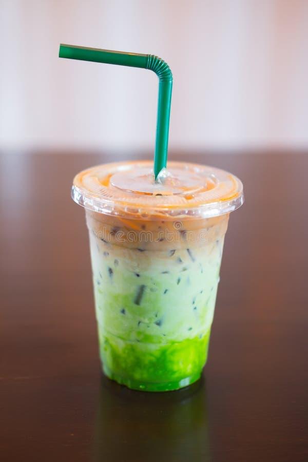 Fusão do café de gelo café de três camadas, leite e chá verde de Matcha fotografia de stock
