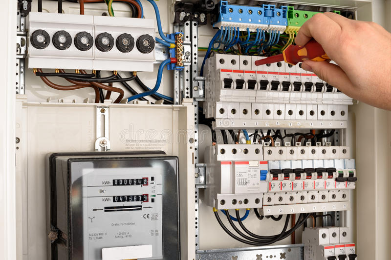 Fuse box. Men working in a Fuse box royalty free stock photography
