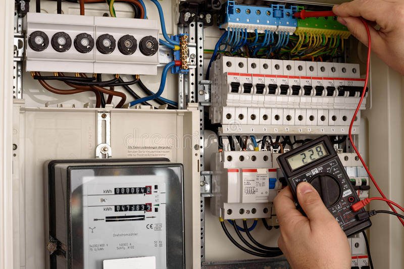 Fuse box. Men working in a Fuse box stock images