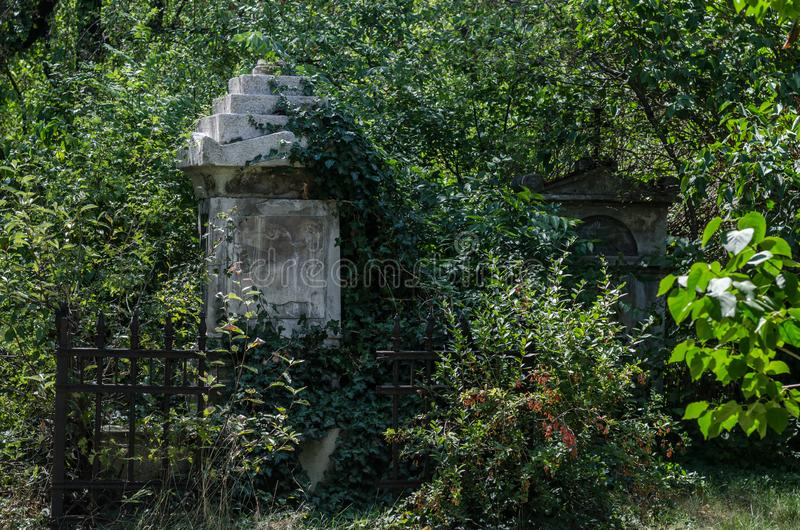 Fused grave with iron fence. Old fused grave with iron fence cross cemetery religion background jesus christianity faith symbol crucifix god catholic holy easter royalty free stock images