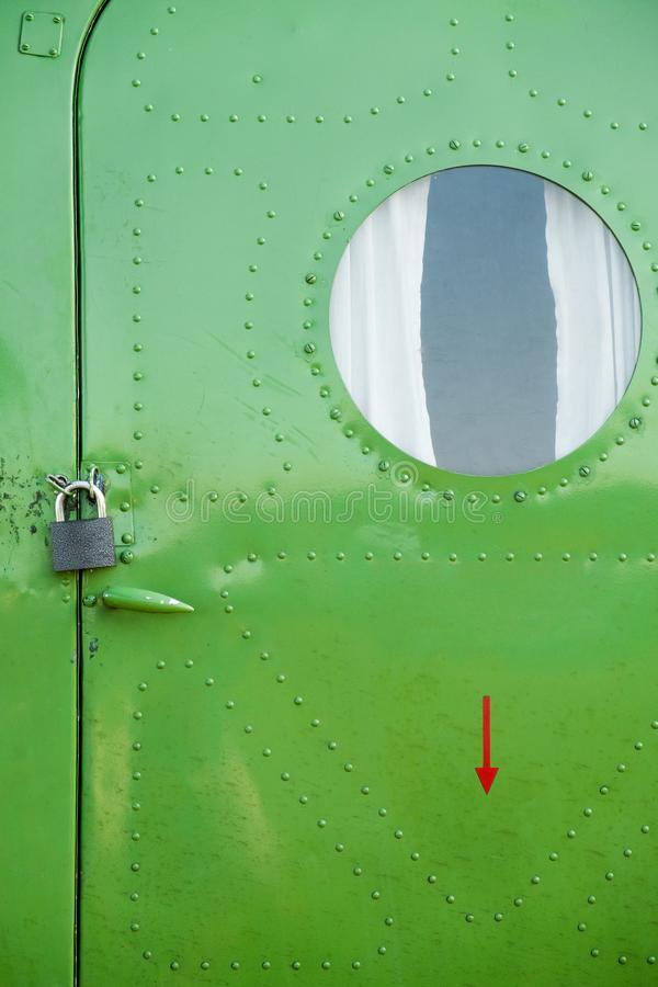 The fuselage of the aircraft is green. Background stock photography