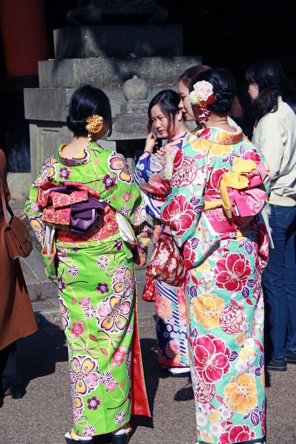 Behind of three Japanese woman in Kimono dress at Fushimi Inari Shrine. stock image