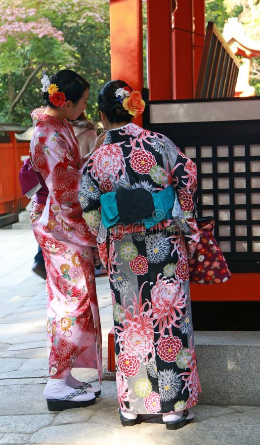 Two woman in Kimono dress at Fushimi Inari Shrine. stock photos