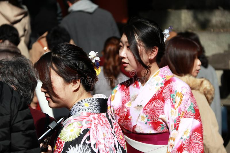 Two woman in Kimono dress among traveller at Japanese Shrine. royalty free stock photo