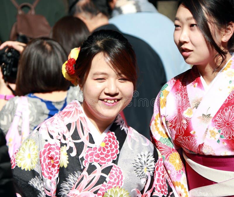 Two woman in Kimono dress among tourist at Fushimi Inari Shrine. royalty free stock image