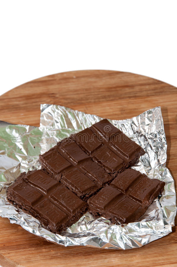Fusión cocinando el chocolate en el tablero de la cocina foto de archivo libre de regalías