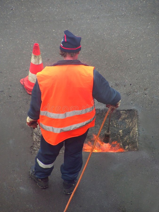 Fusión del asfalto foto de archivo libre de regalías