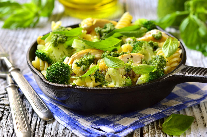 Fusilli with chicken,broccoli and basil pesto. royalty free stock image