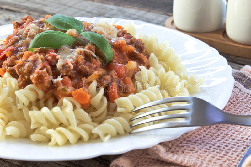Fusilli pasta with bolognese sauce royalty free stock photos