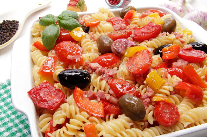 Fusilli pasta with tomatoes, olives and peppers. Food ingridients fusilli pasta with tomatoes, olives and peppers royalty free stock photo