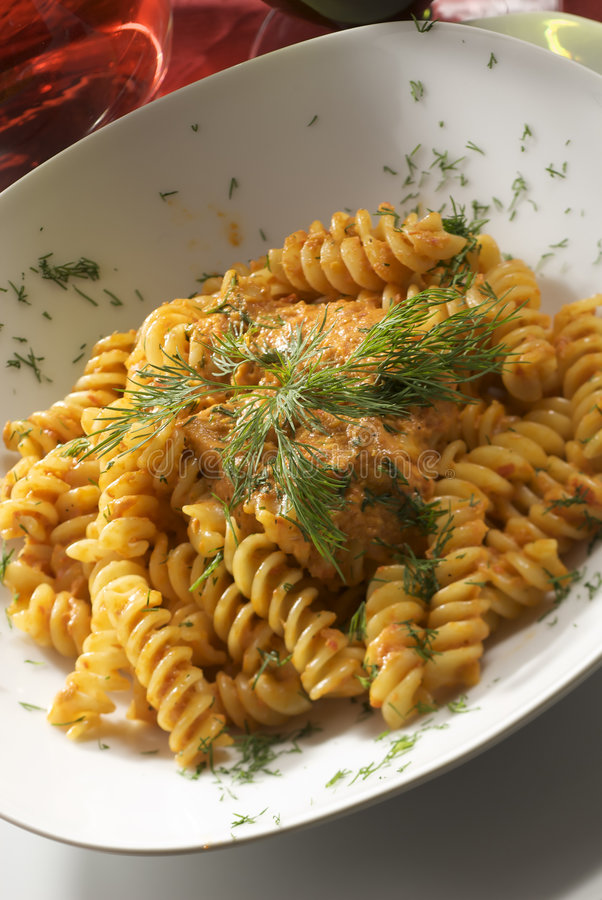 Fusilli with tomato sauce and herb stock images