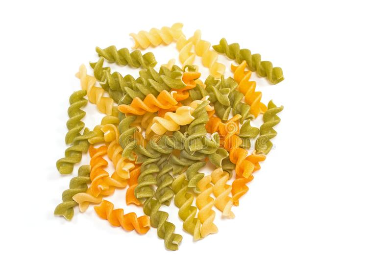 Fusilli tricolore raw dry pasta pile isolated on white stock photography