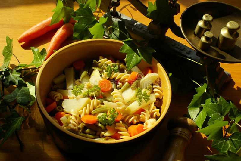 Fusilli with vegetables stock images