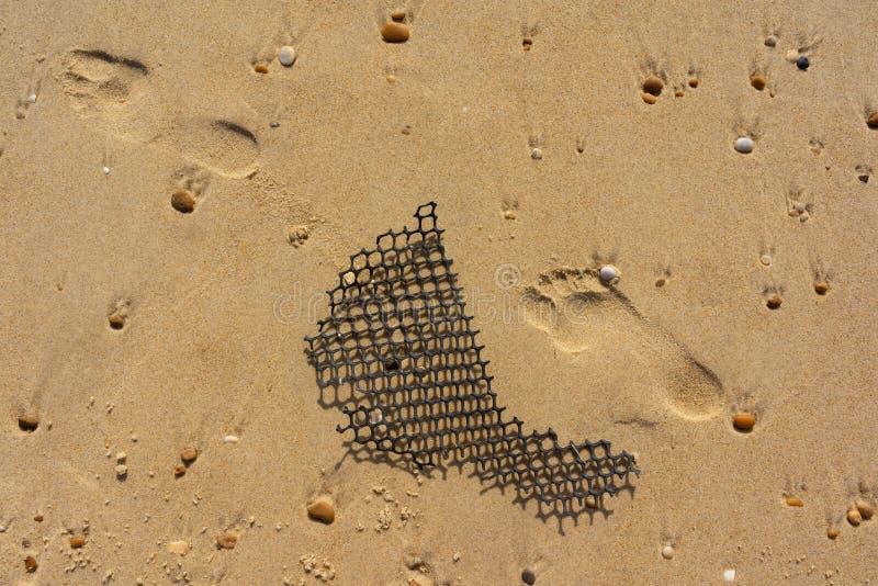 Fuss-Drucke im Sand lizenzfreies stockfoto