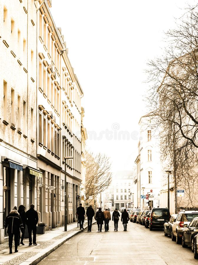 Pedestrians in a small side street in Berlin. Prenzlauer Berg royalty free stock photo