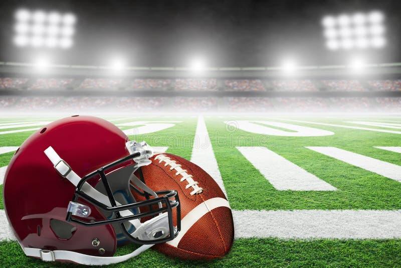 Futbol Amerykański i hełm na polu Z stadiów światłami i kopii przestrzenią zdjęcia royalty free
