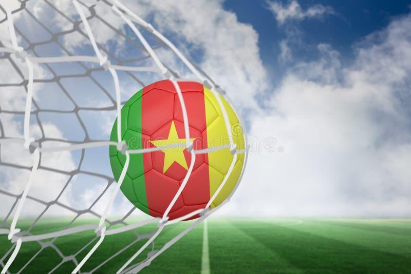 Futbol w Cameroon colours przy plecy sieć zdjęcie royalty free