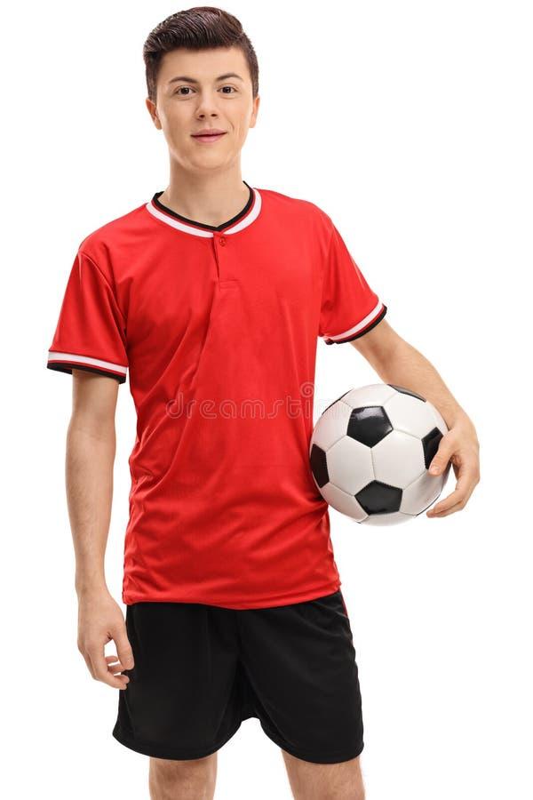 Futbolista adolescente en un jersey rojo foto de archivo libre de regalías