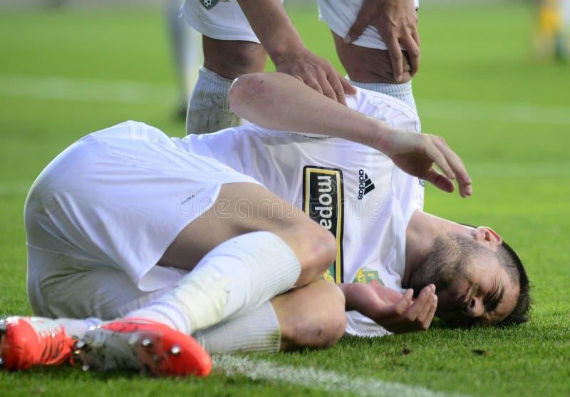 Futbolista dañado fotografía de archivo