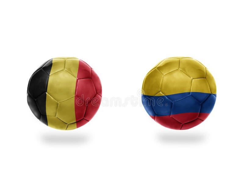 Futbolowe piłki z flaga państowowa Belgium i Colombia royalty ilustracja