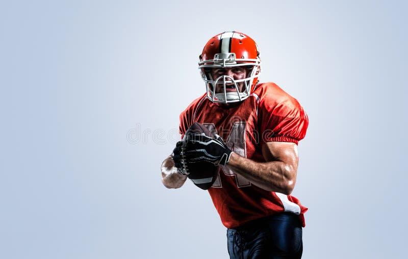 Futbolu amerykańskiego gracz w akcja bielu odizolowywającym zdjęcia royalty free