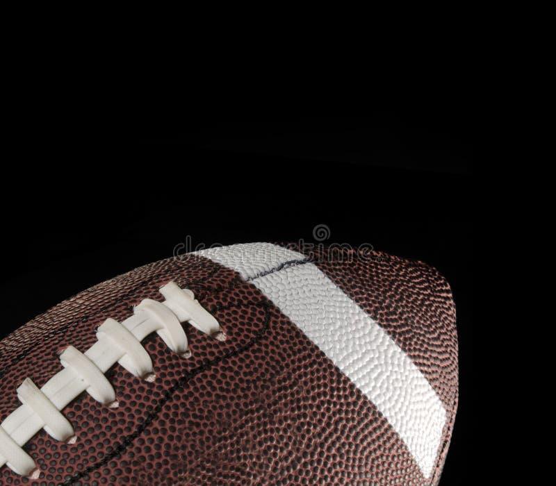 Futebol americano com fundo preto. imagem de stock
