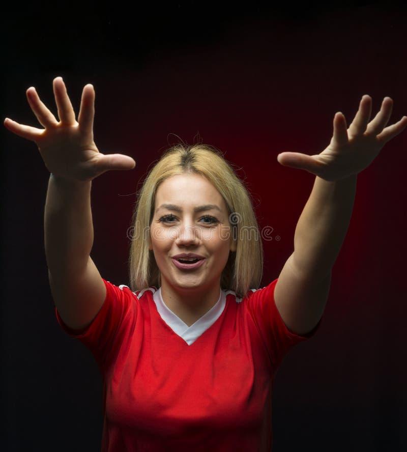 Futebol da mulher que cheering a equipe fotografia de stock