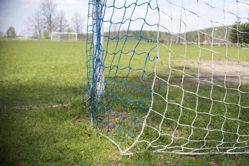 Futebol líquido amador do objetivo do futebol fotos de stock