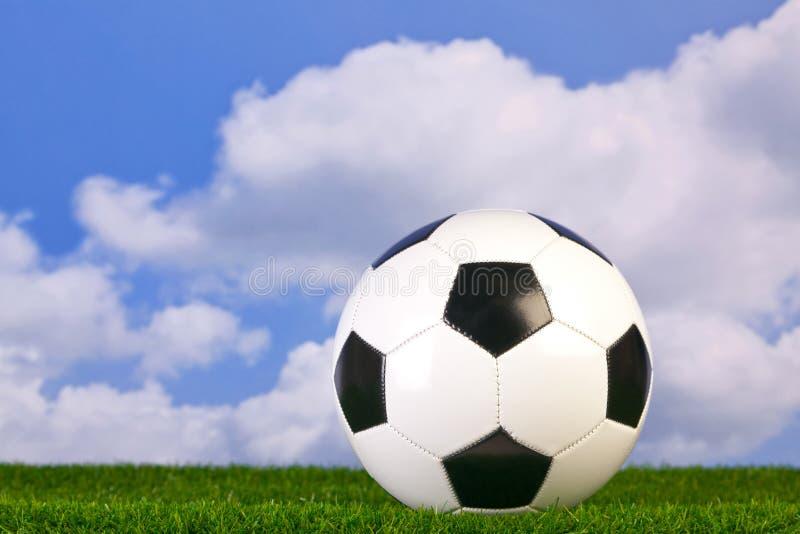 Futebol na grama imagem de stock royalty free
