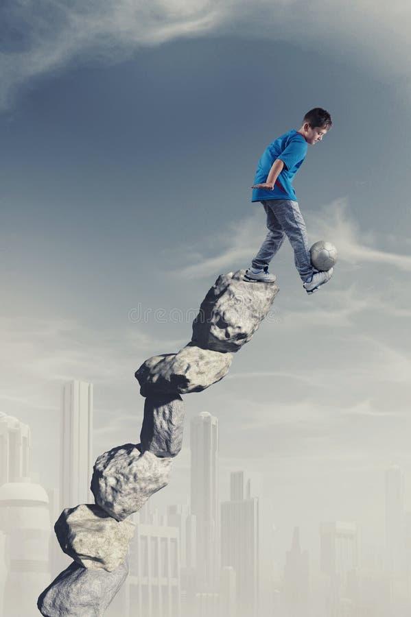 Futebol na pilha de pedras imagem de stock royalty free
