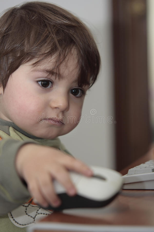 Download Boy with computer mouse stock photo. Image of interactive - 14452320