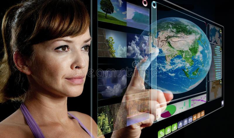 Future 3d display. Businesswoman works with huge 3D panel stock image