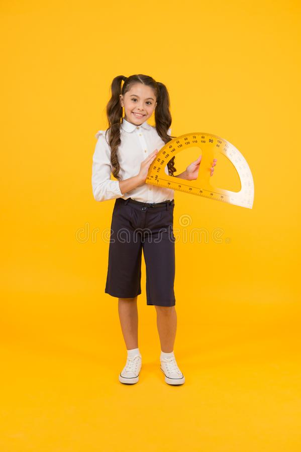 Future architect. Engineering course. Geometry concept. Schoolgirl holding protractor for lesson. Little child preparing royalty free stock images