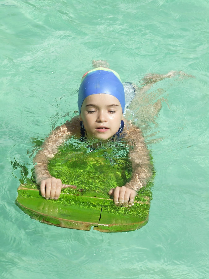 Future champion. First time in the water royalty free stock images