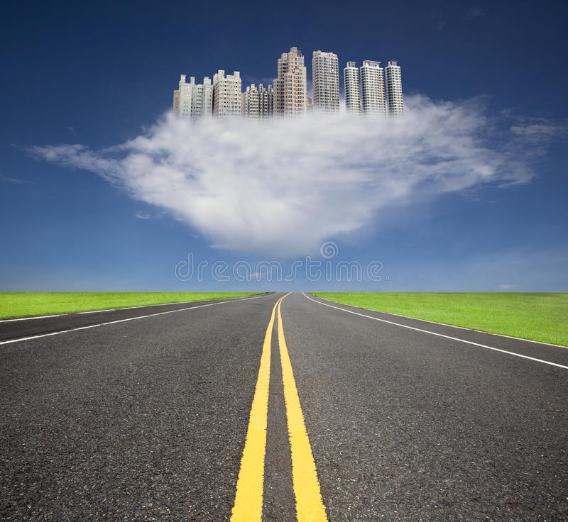 The future city with cloud concept. The road to the future city over the cloud royalty free stock photo