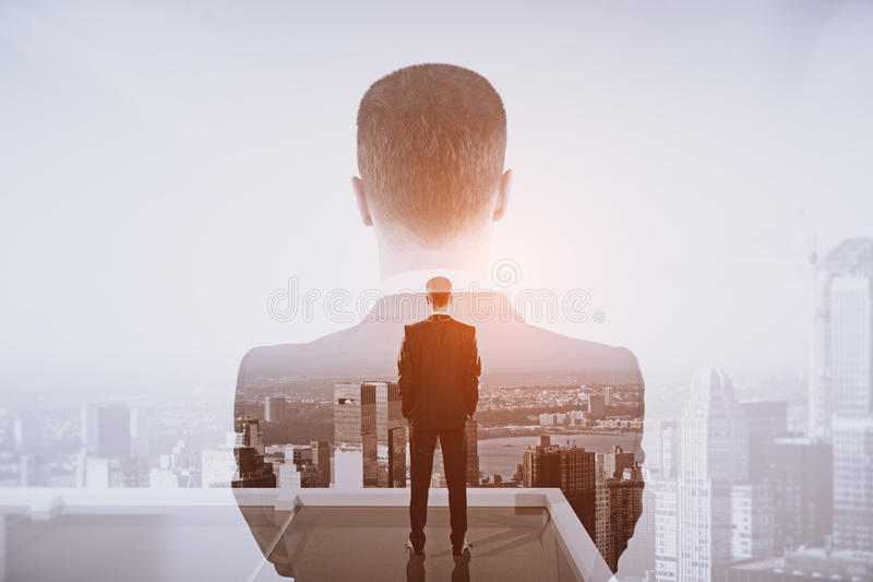 Future concept. Back view of thoughtful businessman on rooftop. Double exposure. Future concept stock illustration