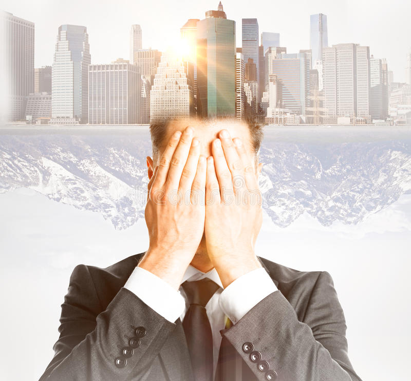 Future concept. Businessman covering face with hands on abstract city background with sunlight. Double exposure. Future concept stock photo