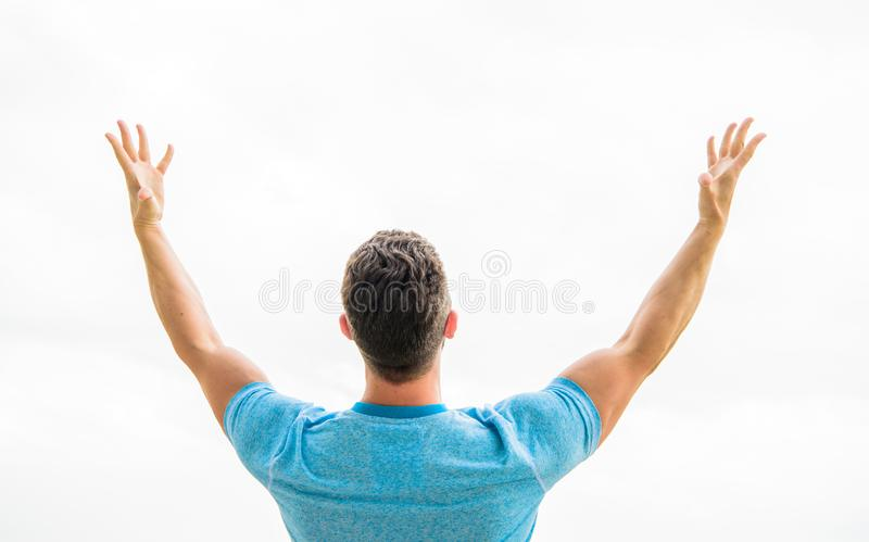 Future concept. Looking forward in future. Strong muscular body feeling powerful rear view. Successful athlete. Victory royalty free stock images